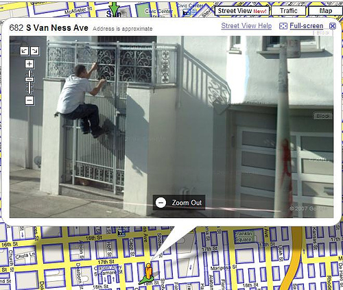 Google streetview catches a robber. Or someone who forgot his keys?